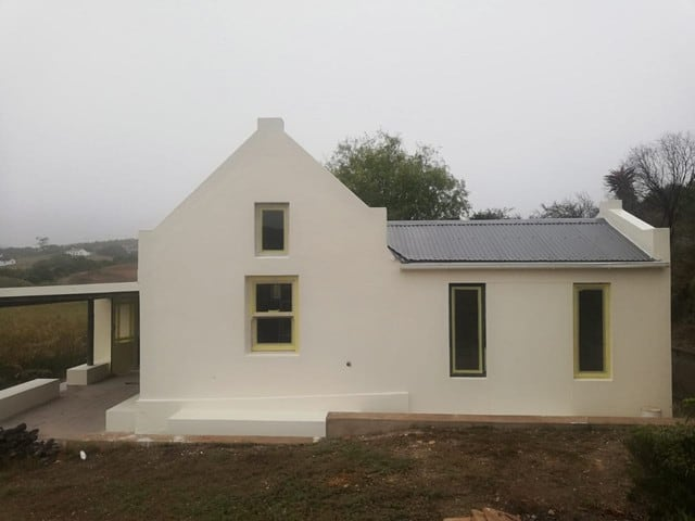 new repainted white classic house at Boumag Construction