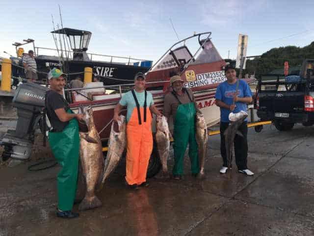 Fishing Charter Stilbaai- Diepsee Hengel Stilbaai Fisherman by the Boat